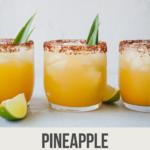 pinterest image of three glasses of pineapple margarita