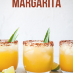 pinterest image of pineapple margarita drinks in glasses close up front