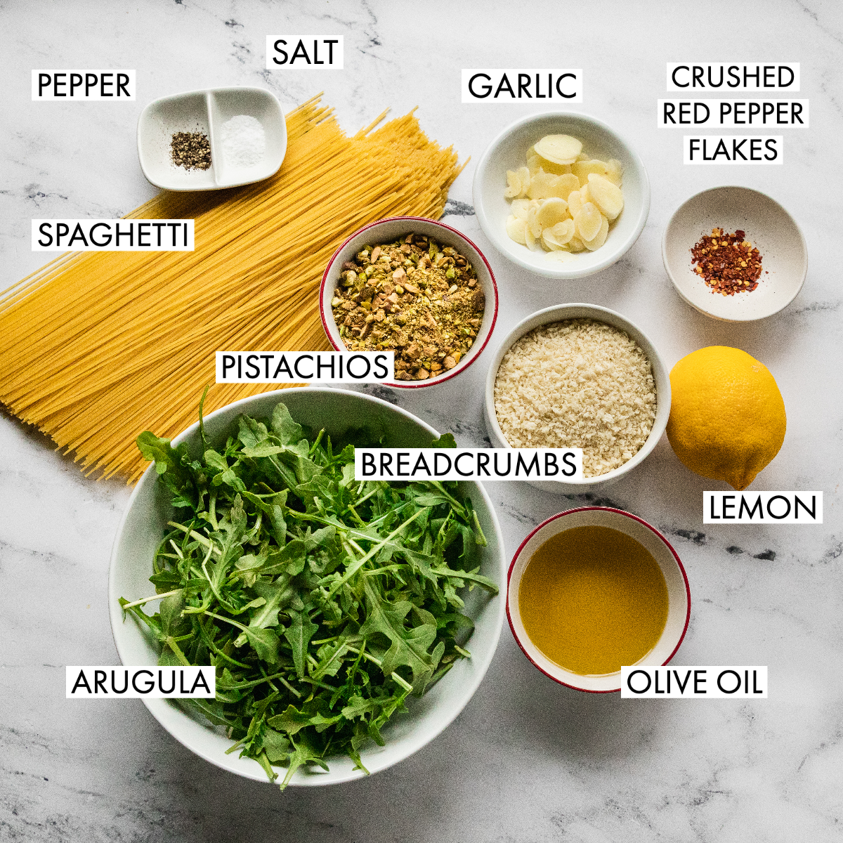 image of ingredients for angel hair noodles with arugula and pistachio
