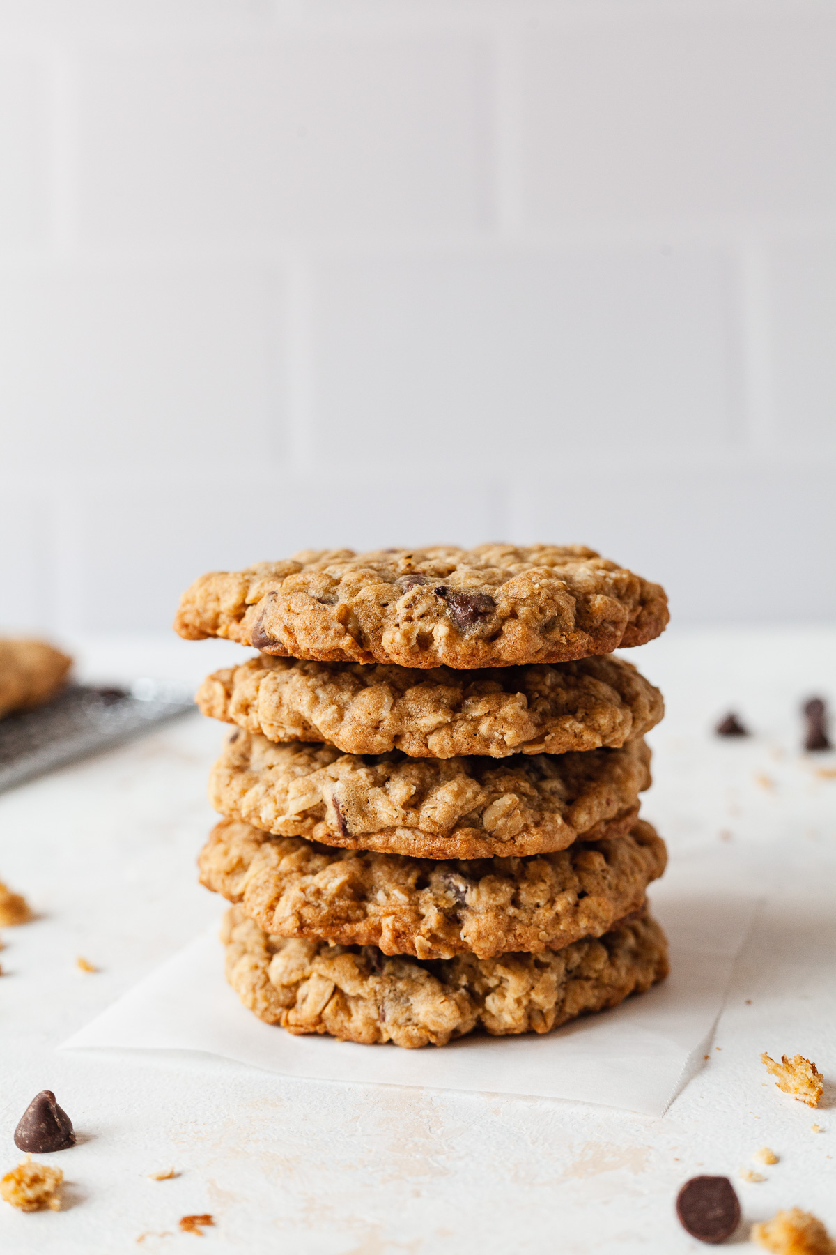 image of oatmeal cookies stacked on top of each other on parchment paper