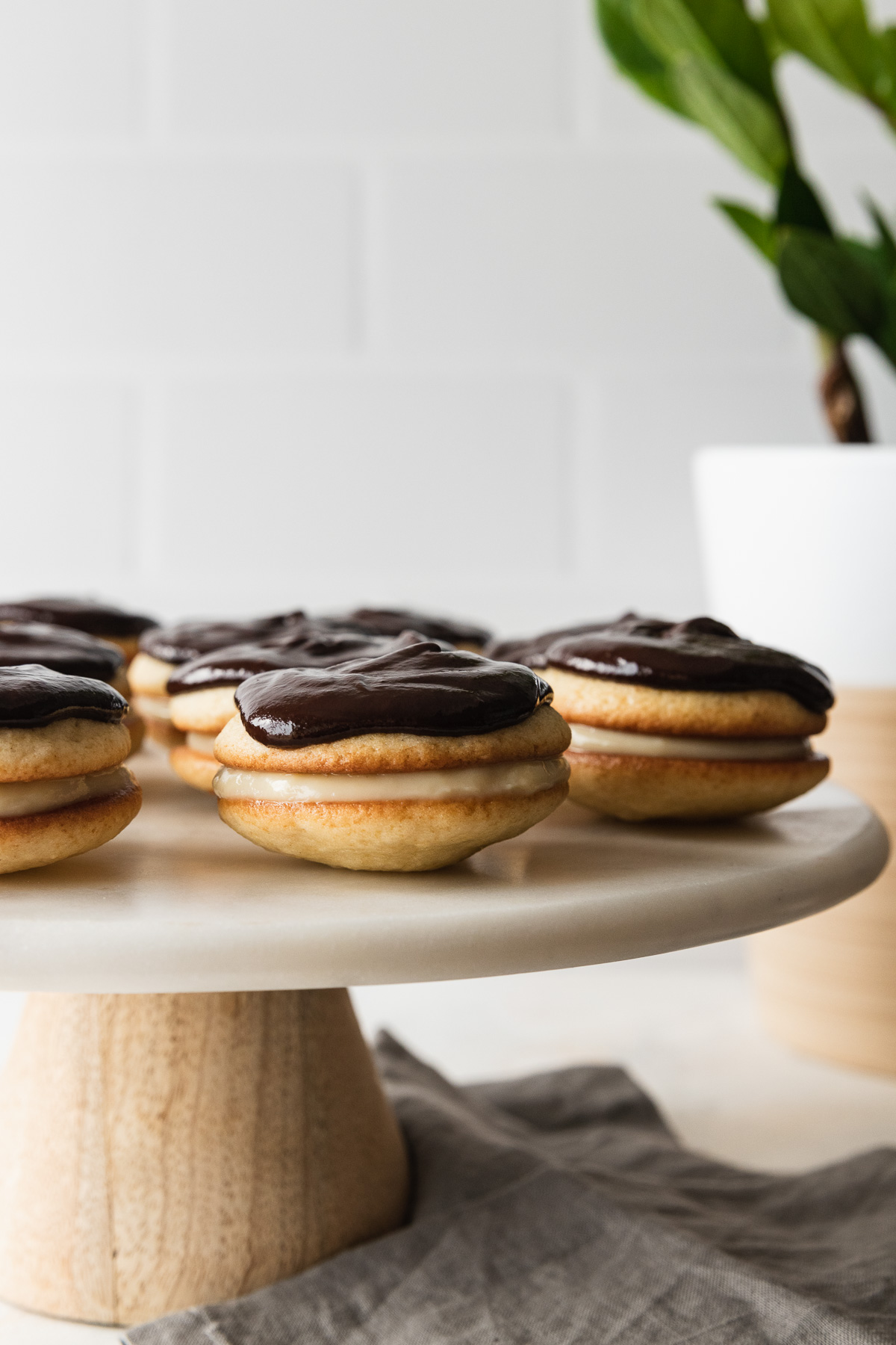 boston cream whoopie pies on a cake stand