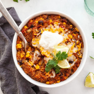 featured image of quinoa enchilada in white bowl with fork inside