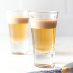 featured image of two shot glasses with buttery nipple shot