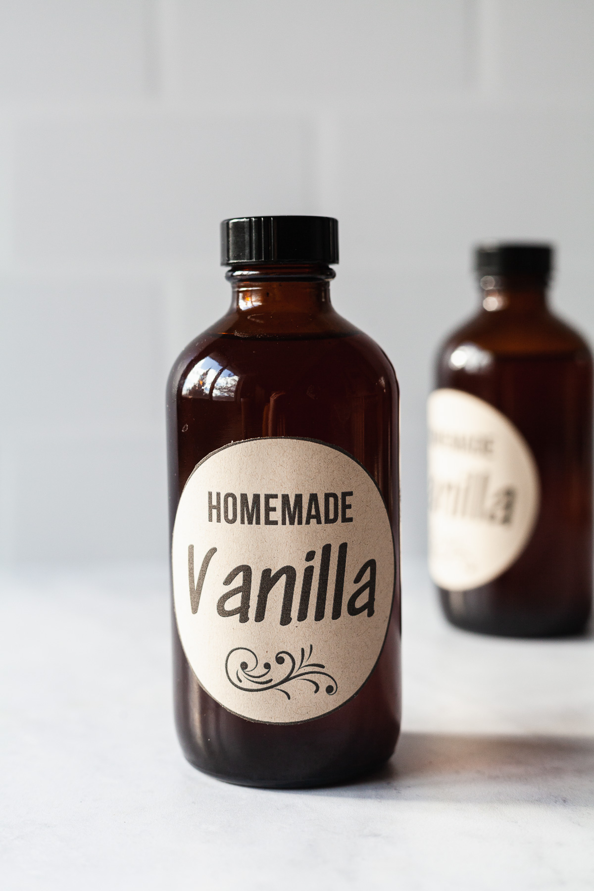 image of two amber glass bottles filled with homemade vanilla