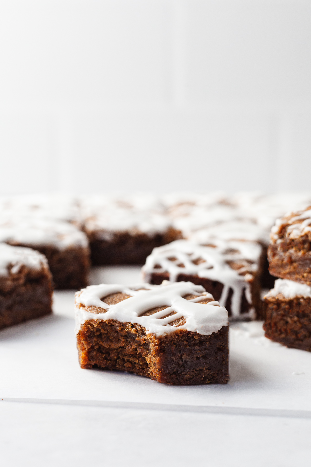 side view image of gingerbread bars cut with one bitten into
