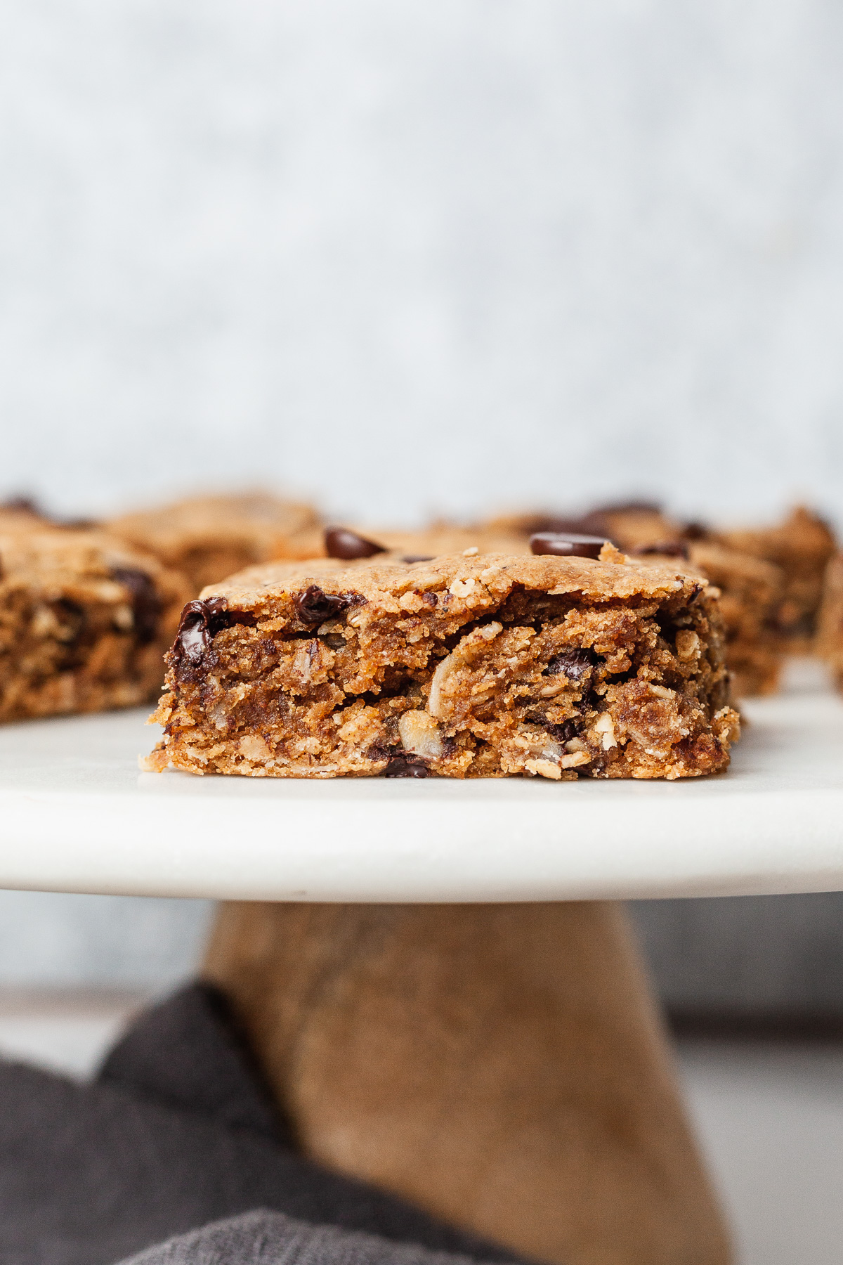 side view image of peanut butter oat bars on cake plate