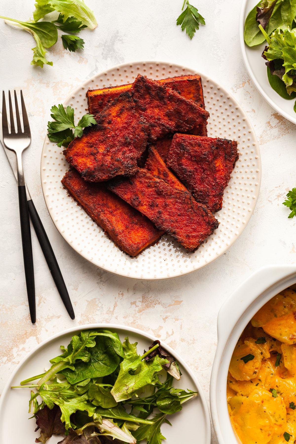 image of vegan tofu ham on plate with side dishes on the side