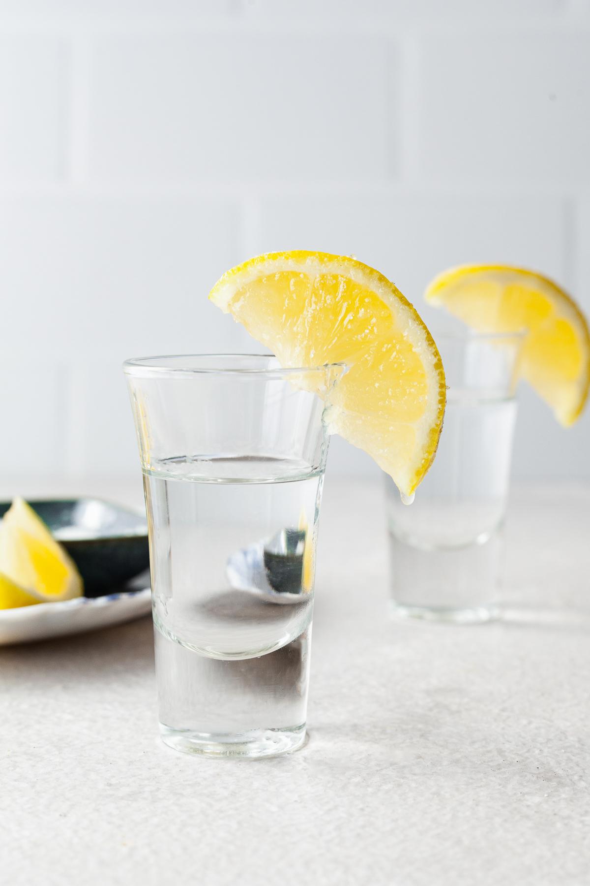 image of two lemon drop shots with lemon slices on glasses