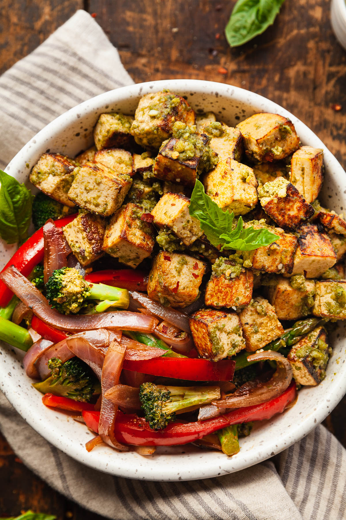 a bowl of pesto tofu with balsamic vegetables