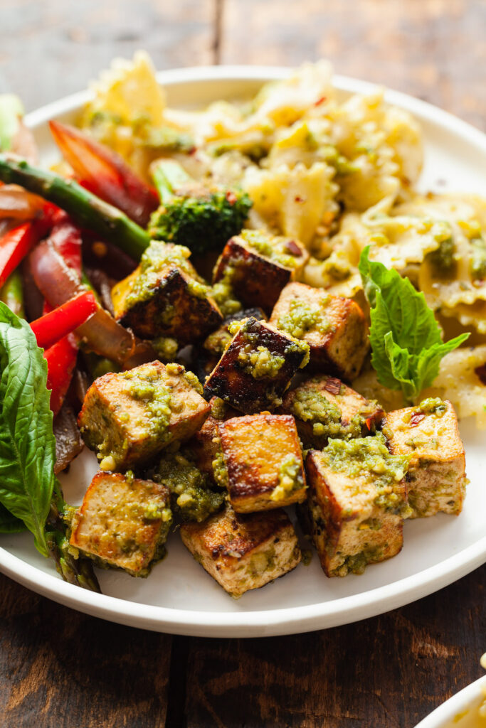 a bowl of pesto tofu with balsamic veggies