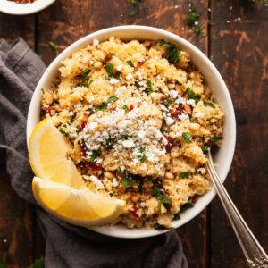 a bowl of mediterranean couscous salad