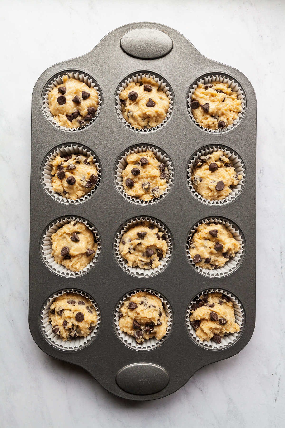 chocolate chip muffins in the pan before baking
