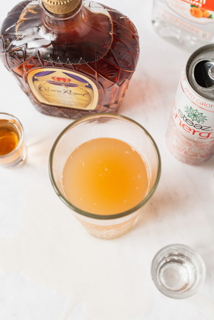a vegas bomb drink on a marble counter with other drinks around