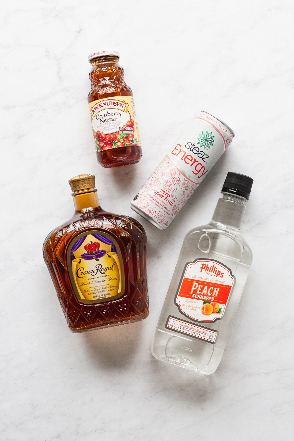 ingredients for a vegas bomb cocktail on a marble table