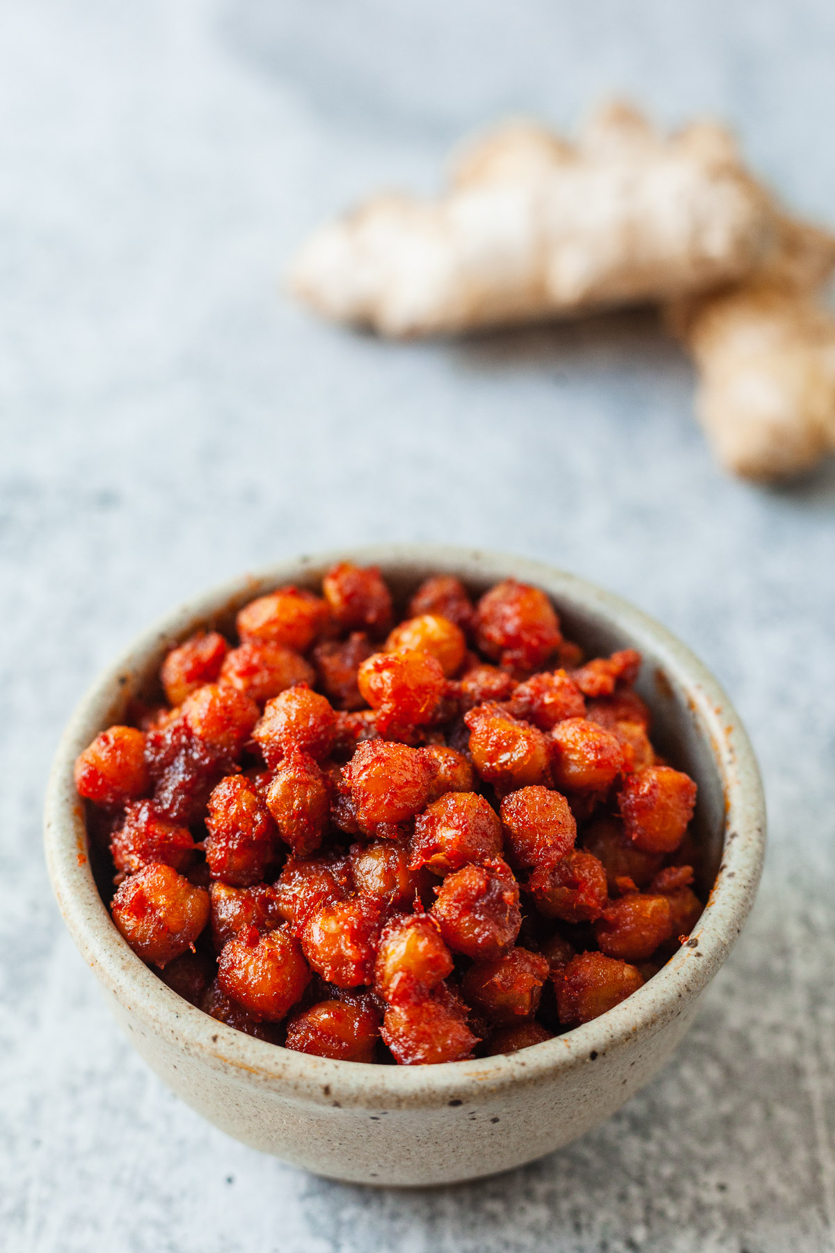 a small bowl of gochujang crispy chickpeas with a knob of ginger