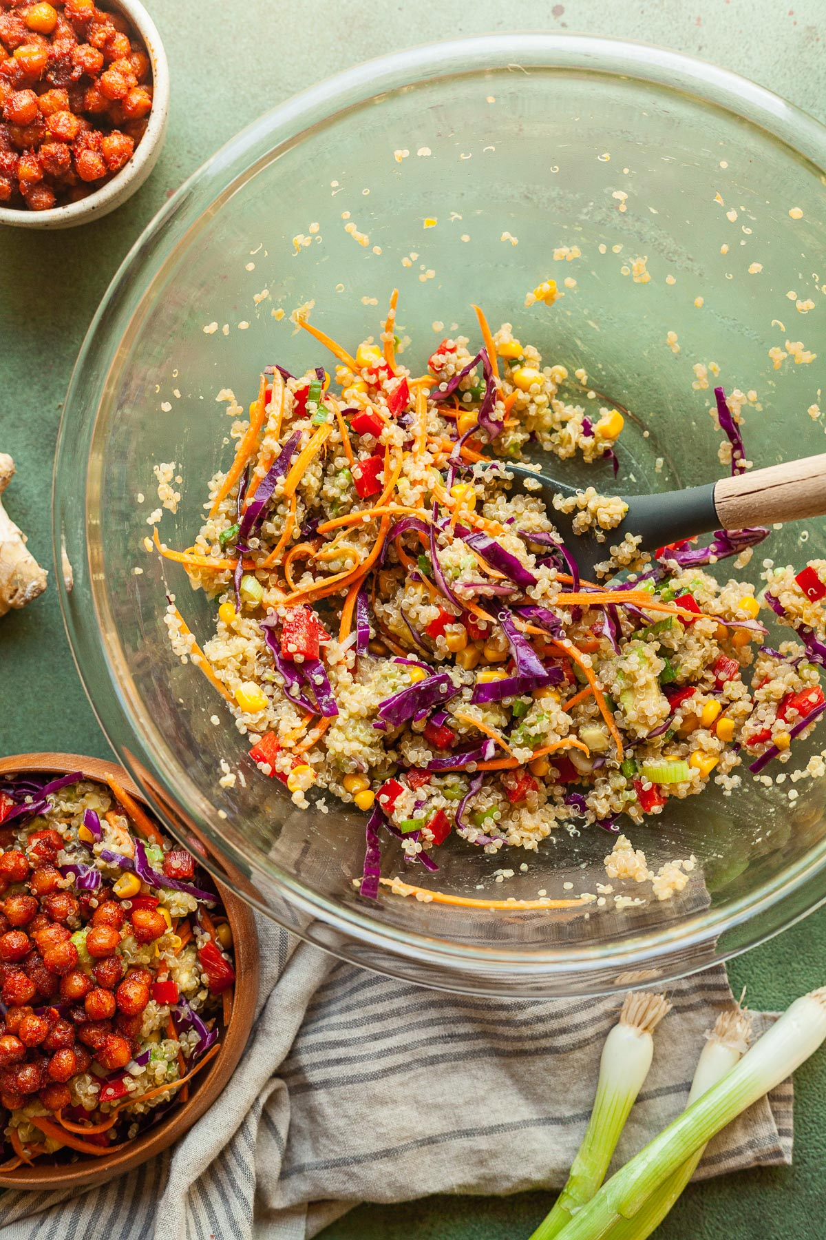 a mixing bowl filled with rainbow quinoa salad
