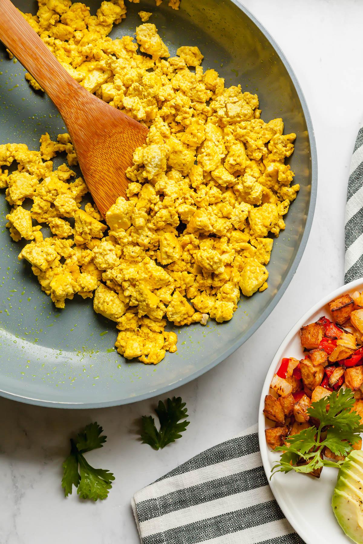 scrambled tofu eggs in a pan