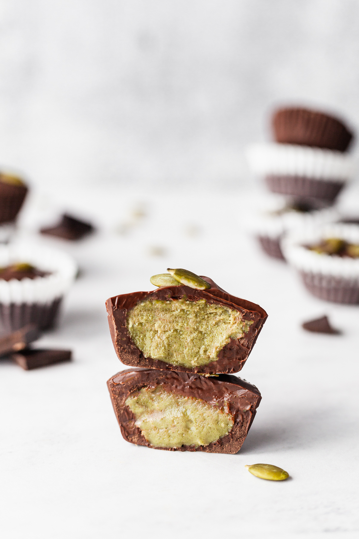 one pumpkin seed butter cup cut in half and stacked