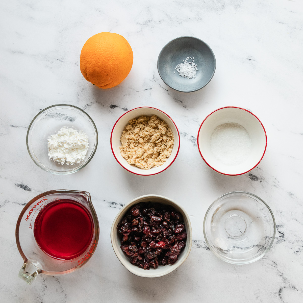 an overhead shot of all the ingredients needed to make cranberry sauce with dried cranberries