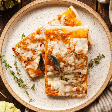 two rectangle slices of pumpkin pizza on a plate
